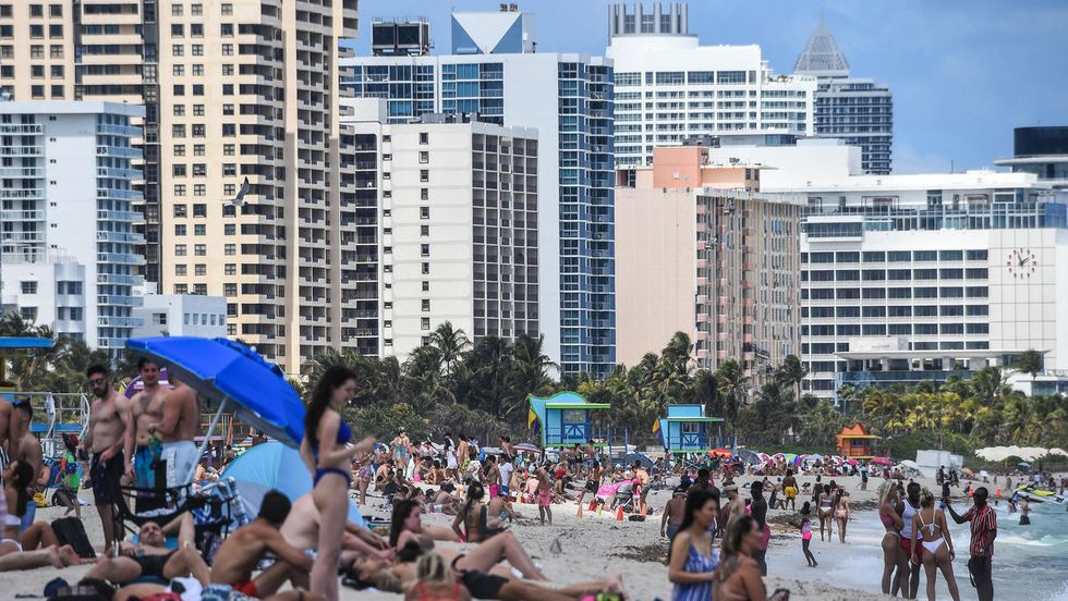 WATCH: Florida residents scramble in 'mad dash' for beach after it reopens