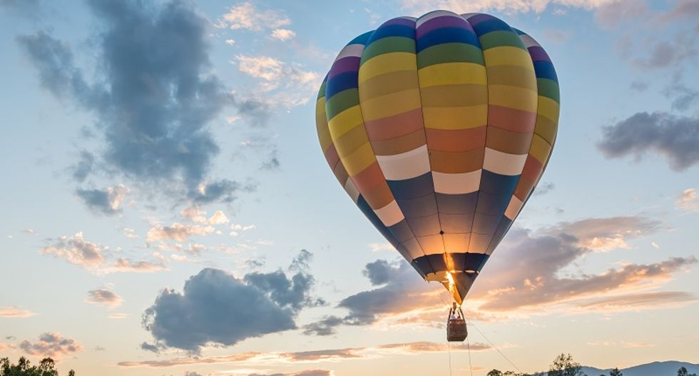 Worker falls to his death trying to hold hot air balloon down for passengers