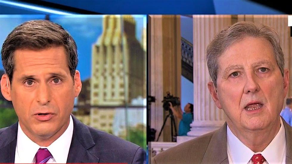 CNN's John Berman makes GOP senator squirm for refusing to condemn Trump's latest attack on the DOJ