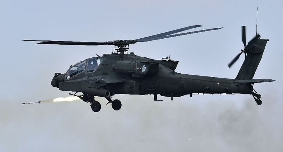 US Apache helicopters strike Islamic State jihadists for first time in Iraq