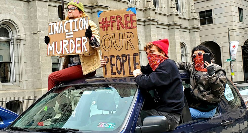 'Inaction is murder': Protesters surround City Hall to demand Philly #FreeOurPeople from jail