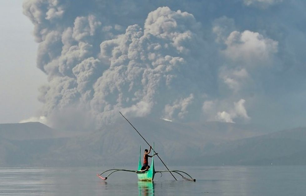 Signs of life at 'no-man's land' around Philippine volcano