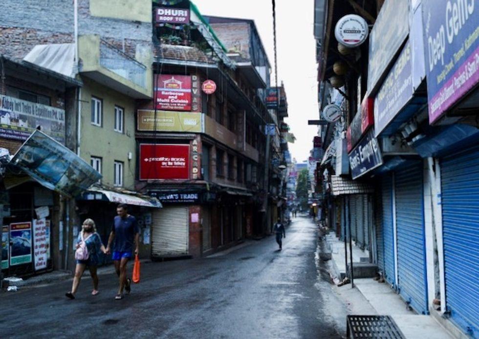 Rescued from Himalaya trails, trekkers find world in turmoil