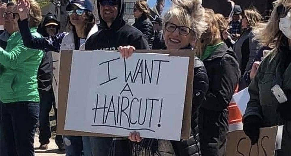 'Social distancing = Communism': These are the stupidest protest signs from rallies to reopen