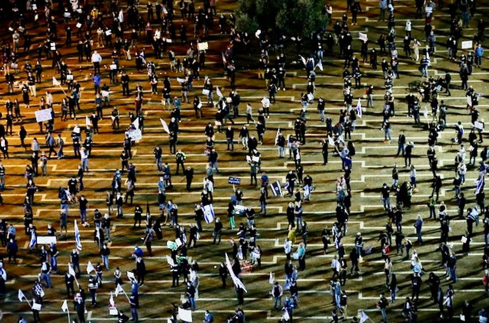 Thousands of Israelis demonstrate to 'let democracy win'