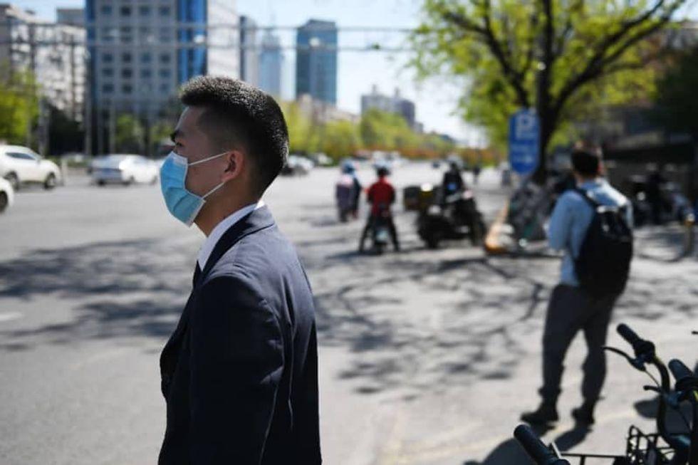 Beijing bans 'uncivilized' behavior to improve public hygiene