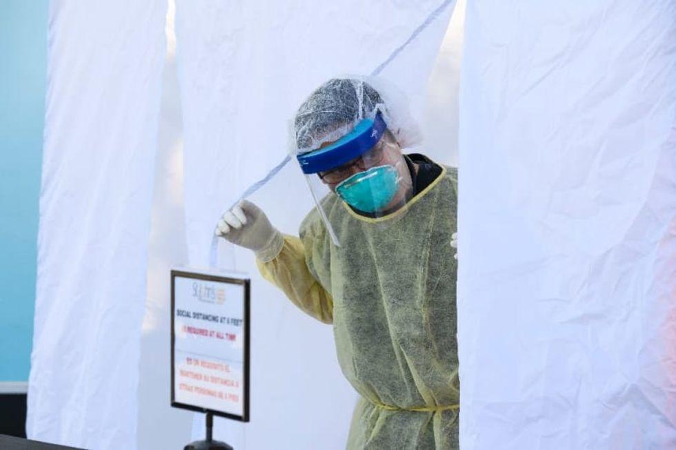 US virus cases hit a million as Germans wear masks in shops
