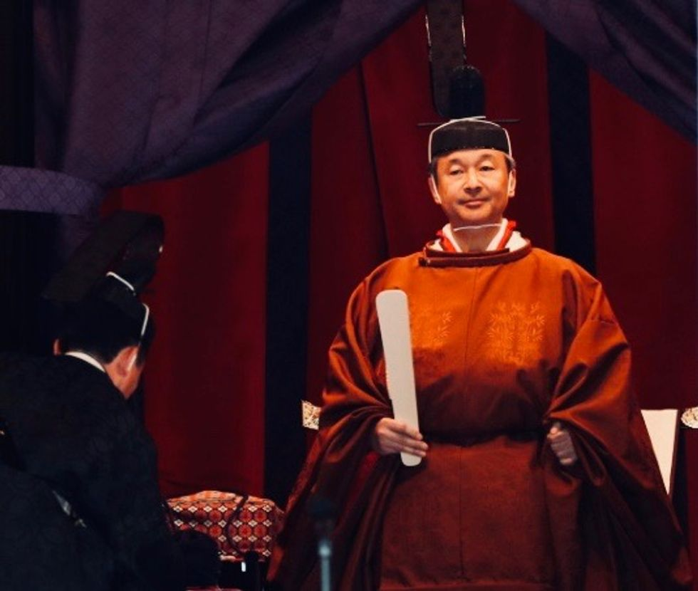 Japan's emperor completes enthronement in ancient ceremony