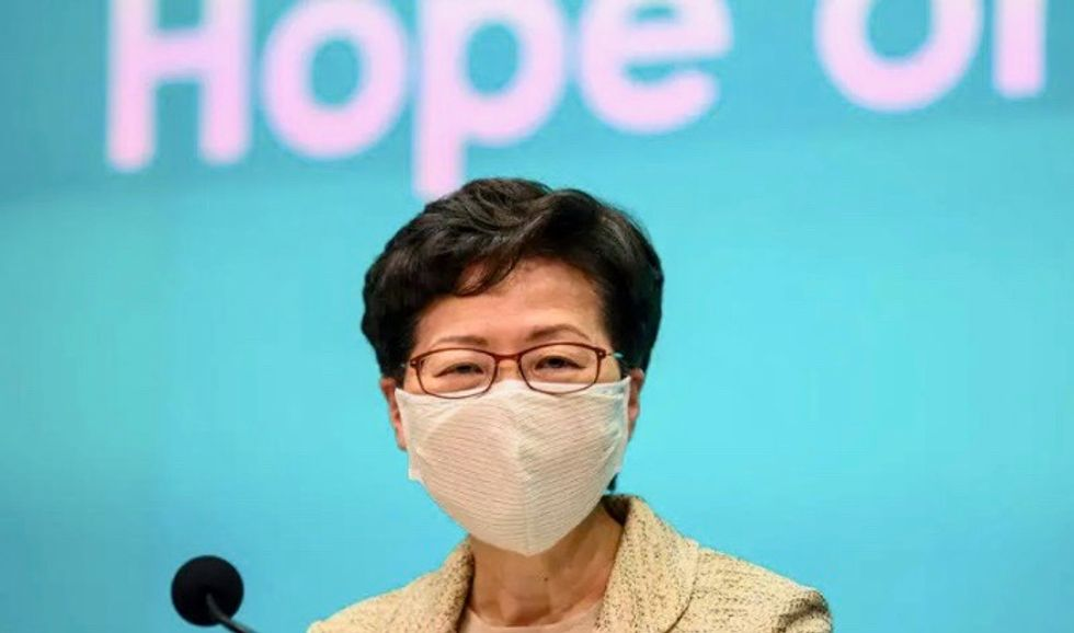 Hong Kong leader tries to reassure investors rattled by China law