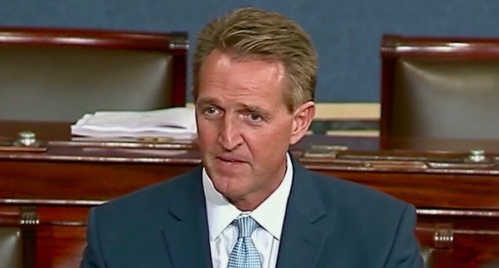 Jeff Flake blames 'all sides' after bombs target prominent Democrats
