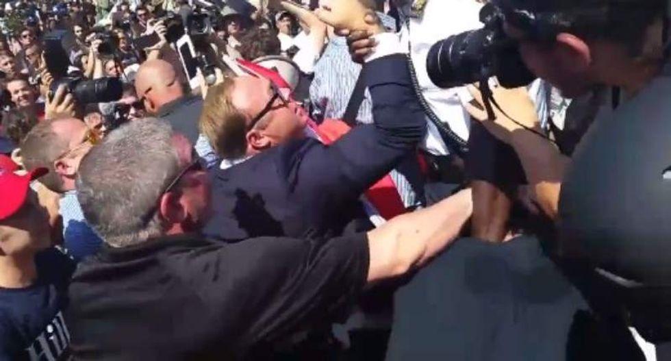Alex Jones clashes with anti-'Nazi scum' protesters in Cleveland