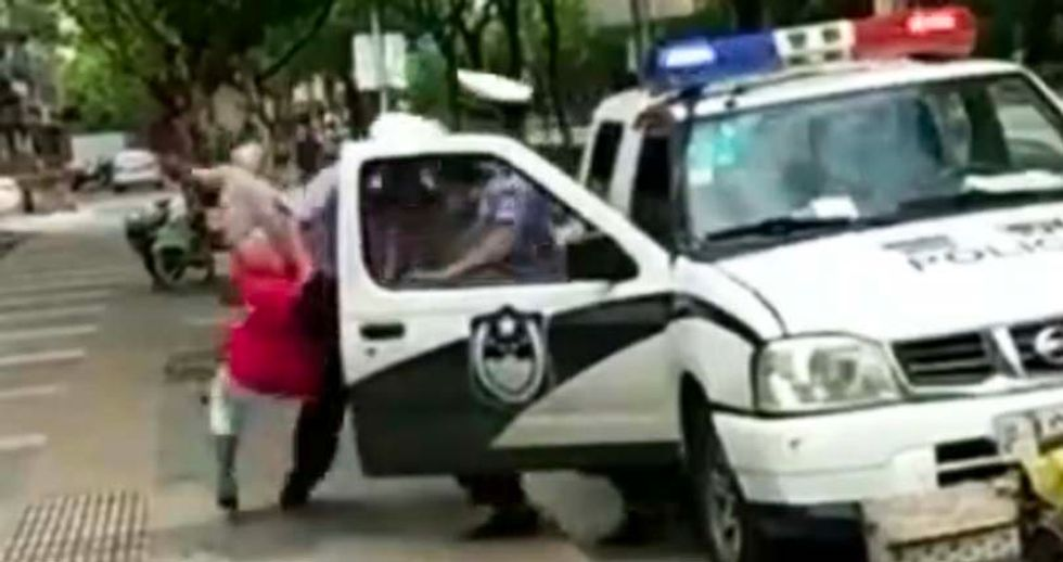 WATCH: Cop slams woman with child in her arms to the sidewalk -- over a parking ticket