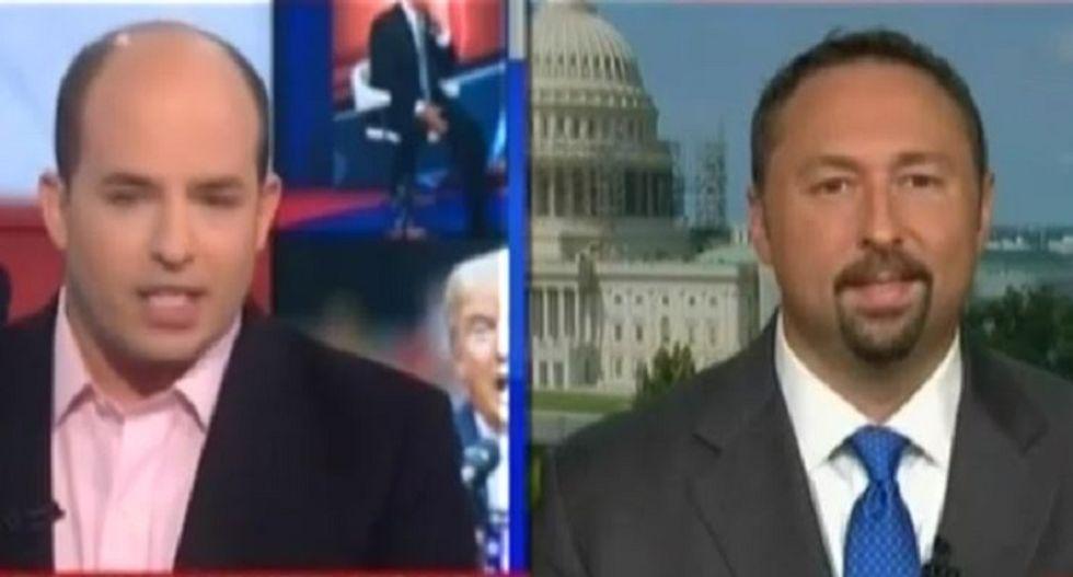 CNN host blasts Trump spokesman for robot-like 'radical Islamic terrorism' response about Khans