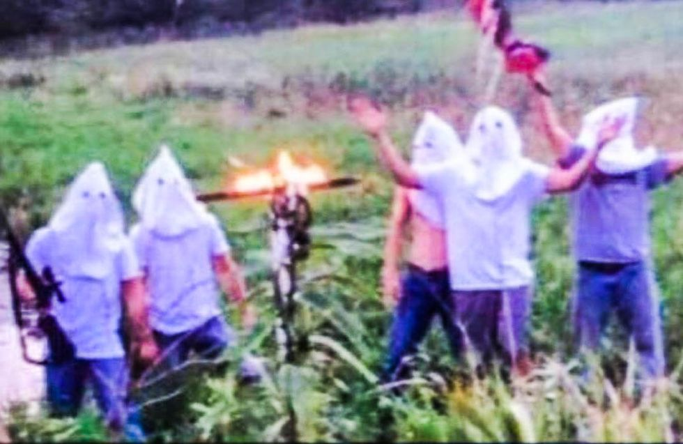 Iowa high school tight-lipped after armed students caught burning a cross in KKK hoods