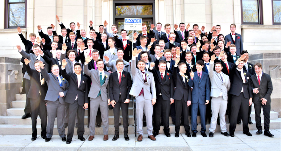 Photographer behind high school 'Nazi salute' photo says boys were told to 'wave' -- but one student says that's not true