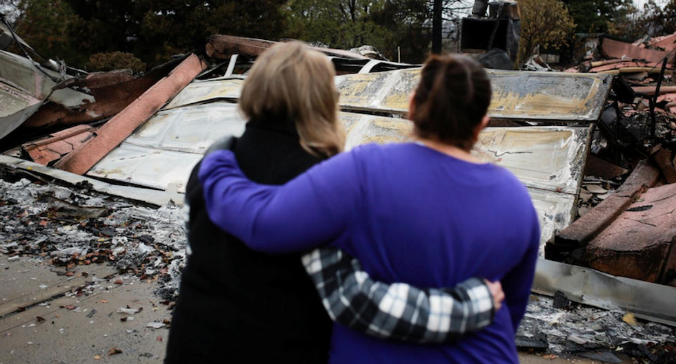 Rain complicates grim task of finding remains of California wildfire