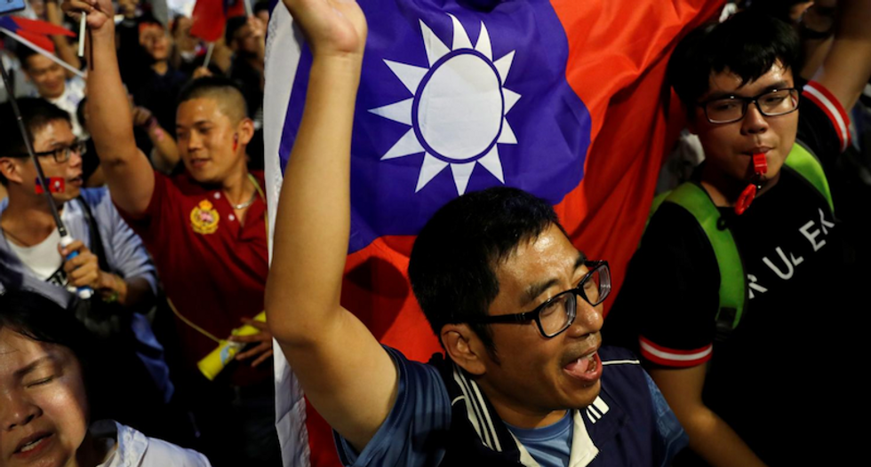 China cheers Taiwan voters after pro-independence ruling party is defeated in elections