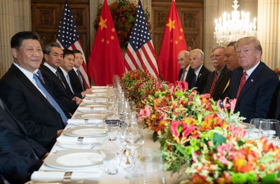 Watch Trump humiliate his own trade rep in front of laughing Chinese guests