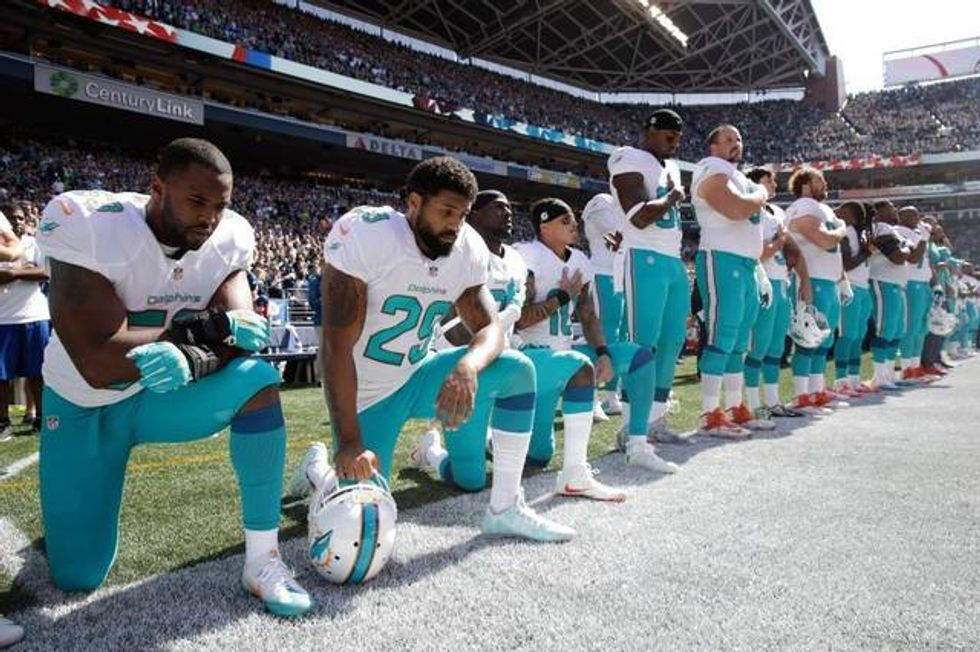 Group of Miami Dolphins players kneel in protest during national anthem