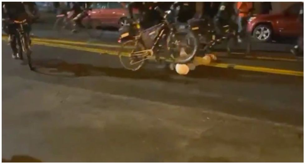 Cop caught on video rolling bicycle over protester's head is placed on administrative leave