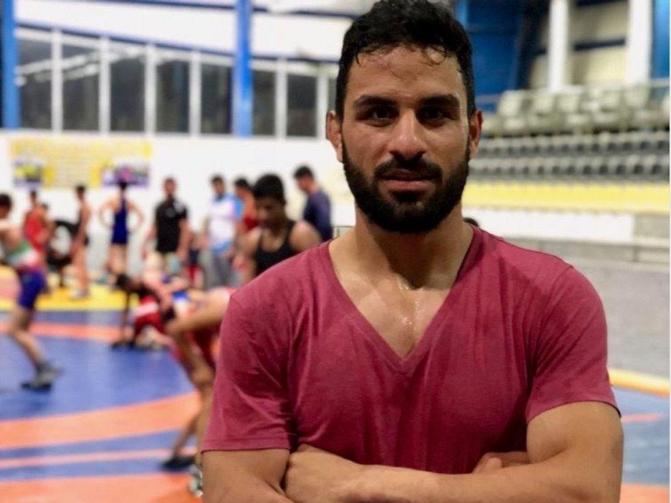 US slaps sanctions on Iran judge over wrestler's execution