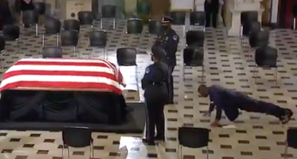 WATCH: Ruth Bader Ginsburg's trainer performs pushups in front of her coffin