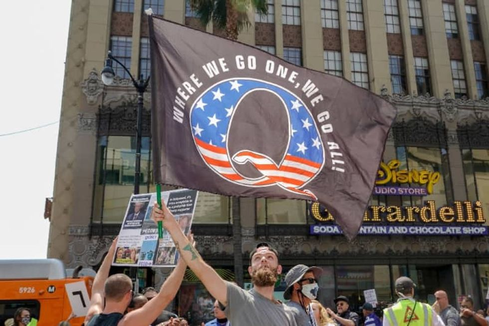 'A perfect storm': Experts worry as QAnon conspiracies go global -- posing 'an incredible threat to public health'