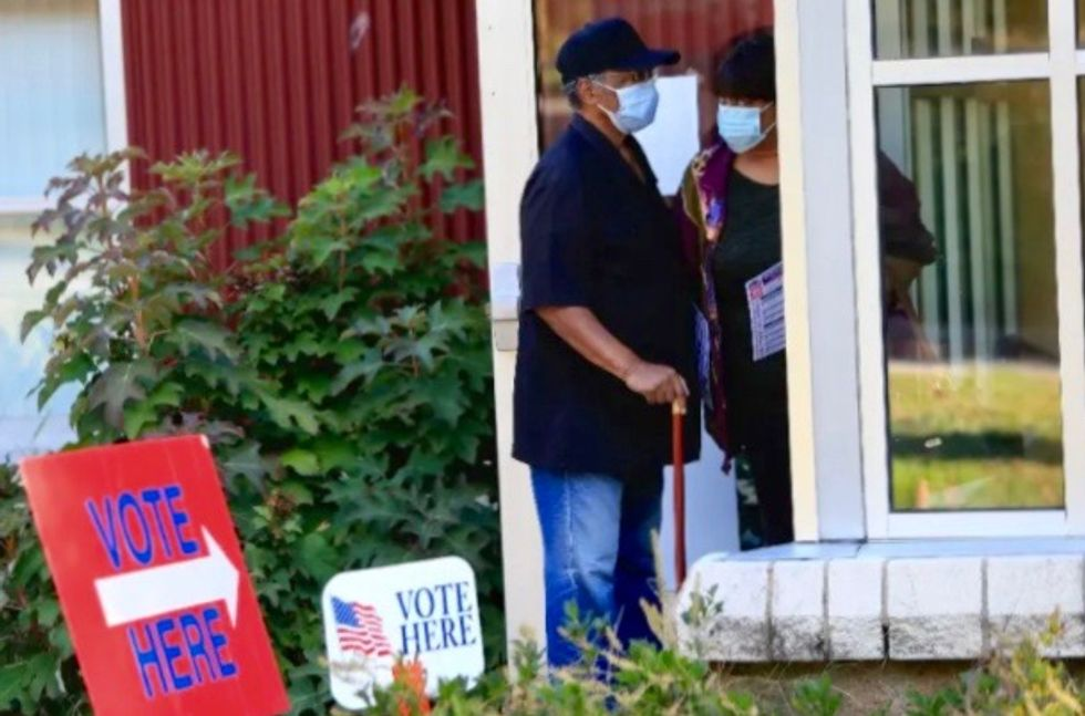 Americans voting early in record numbers in presidential election