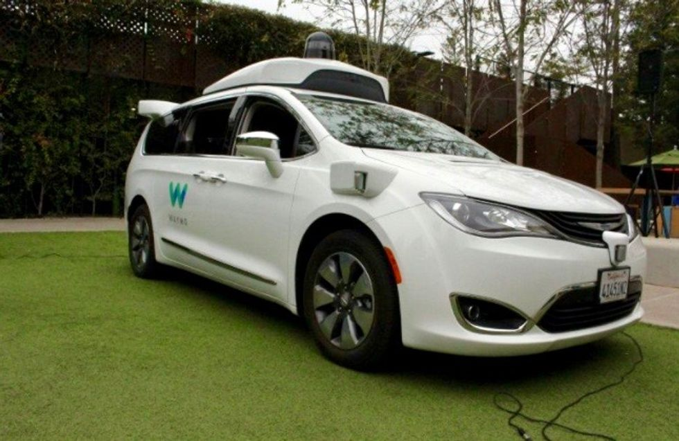 Waymo opens robo-taxi service to the public in Phoenix