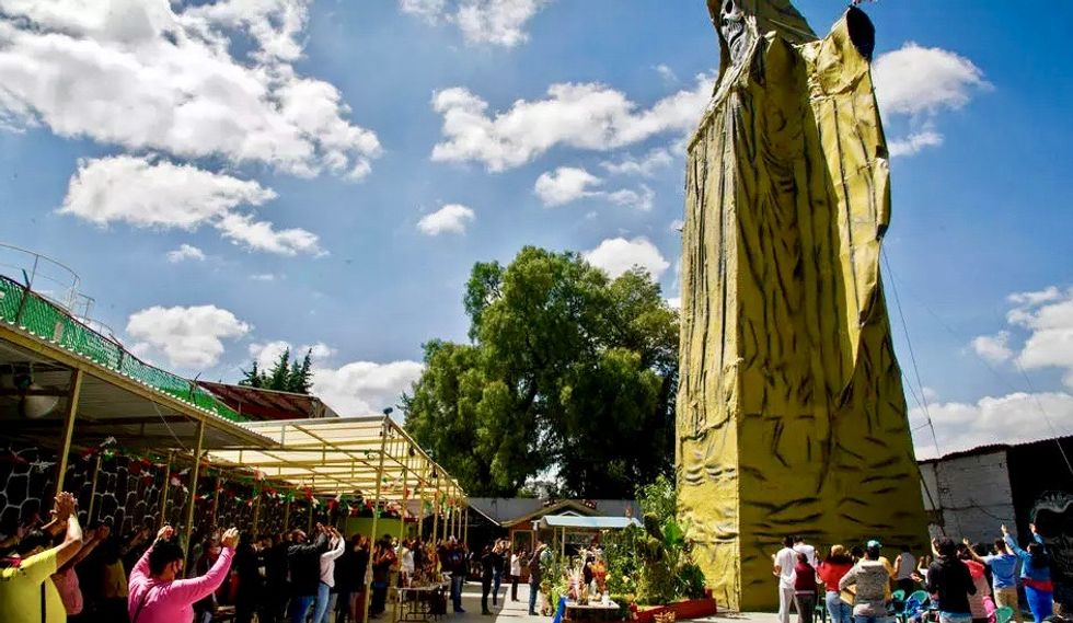As pandemic rages, Mexicans pray to death 'saint'