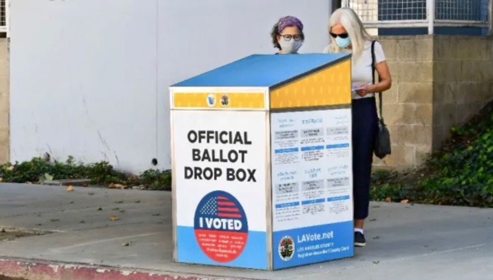 US plows ahead with mail-in voting despite ballot errors