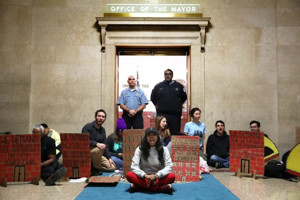 Protesters stage sit-in outside Chicago mayor's office over Obama Presidential Center and affordable housing