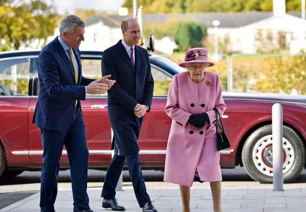 Mask-free Queen ventures outside 'HMS Bubble' to secret lab