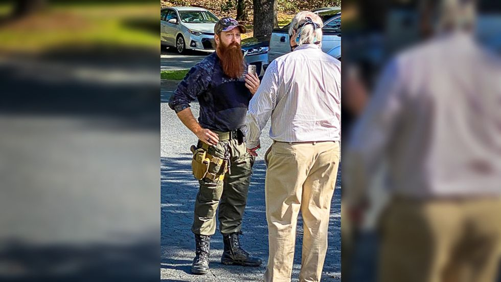 Congresswoman whisked from NC polling precinct after 'maskless white man' shows up with gun