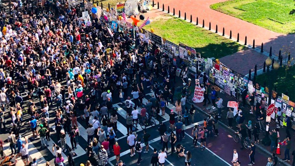 'Na na na na, hey hey hey, goodbye': Massive crowd surrounds White House after Trump defeated by Biden
