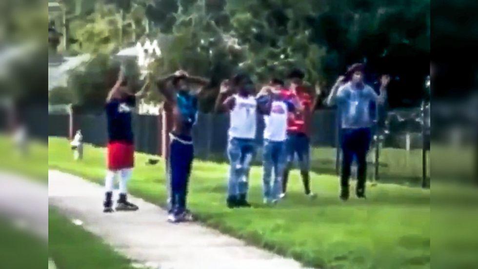 'They are babies!' Bystanders plead with Georgia officers as they hold 5 black children at gunpoint