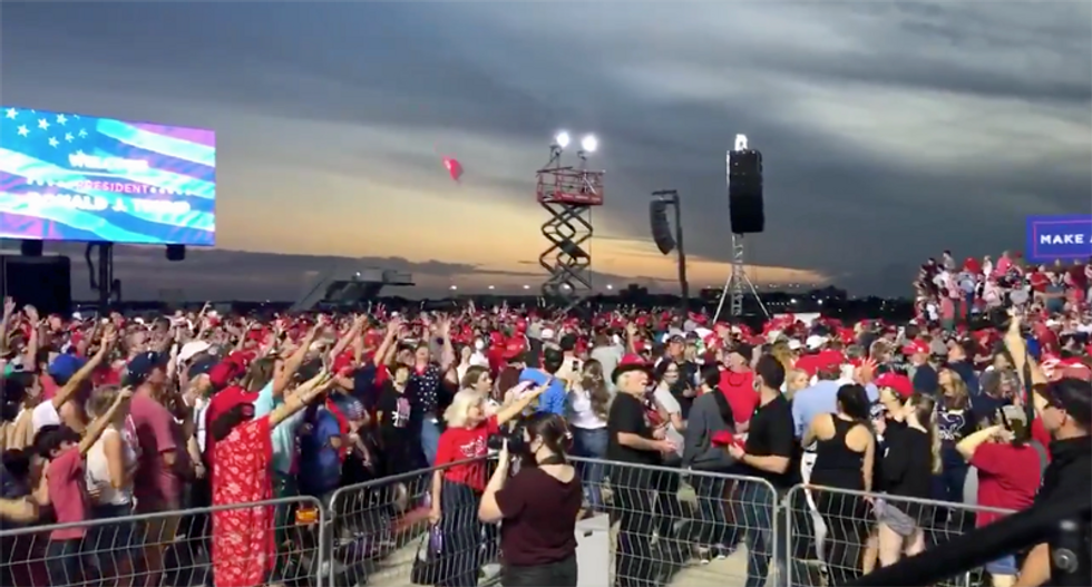 Trump staff ensure there are plenty of MAGA hats — at maskless Florida rally during pandemic