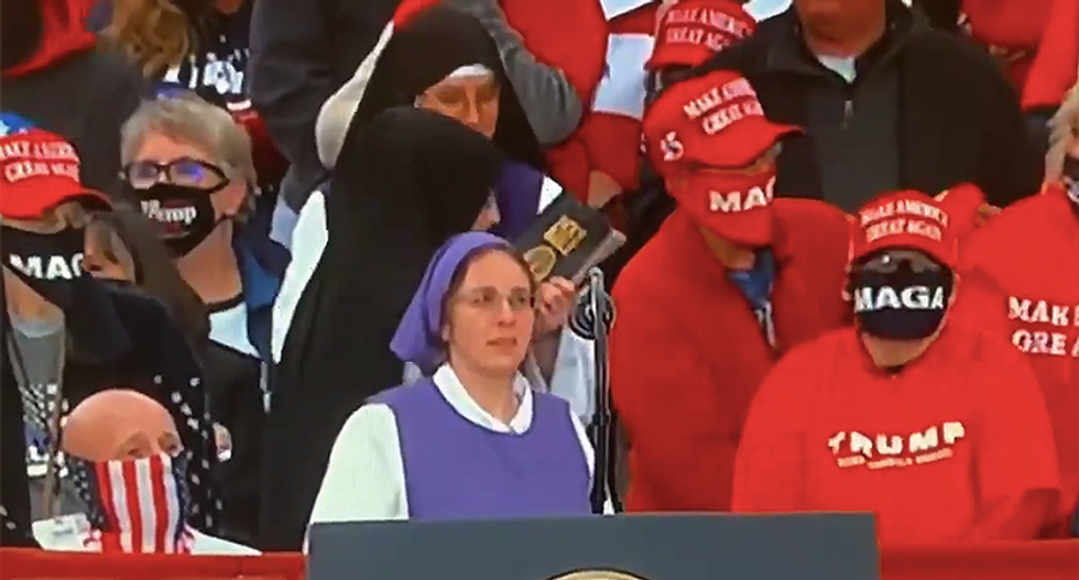 Nuns at Trump rally appear uncomfortable reading their Bible as president runs over an hour late to event