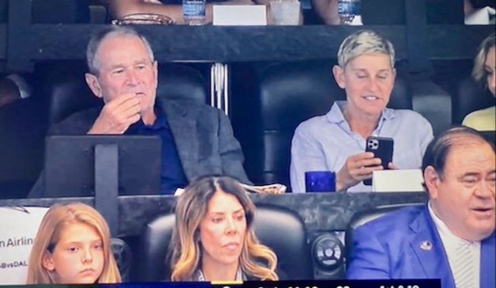 Ellen DeGeneres roasted for sitting next to 'Absolute scum' George W. Bush at football game