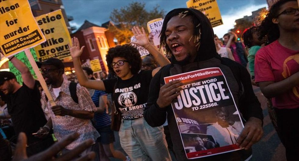Ferguson on edge again after two police officers are shot