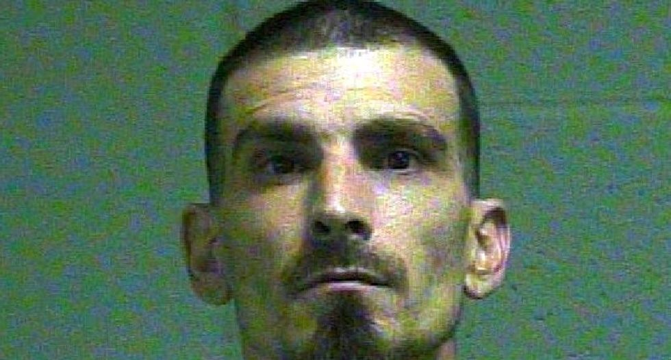 Man arrested for aiding Oklahoma double murderer during police search