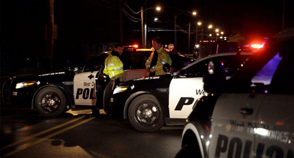 Iowa police identify Scott Michael Greene as suspect in ambush-style slaying of two officers