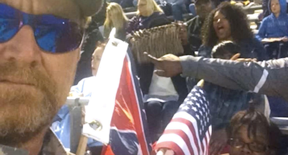 Accused cop killer waved Confederate flag at football game to protest 'cop haters' sitting out anthem