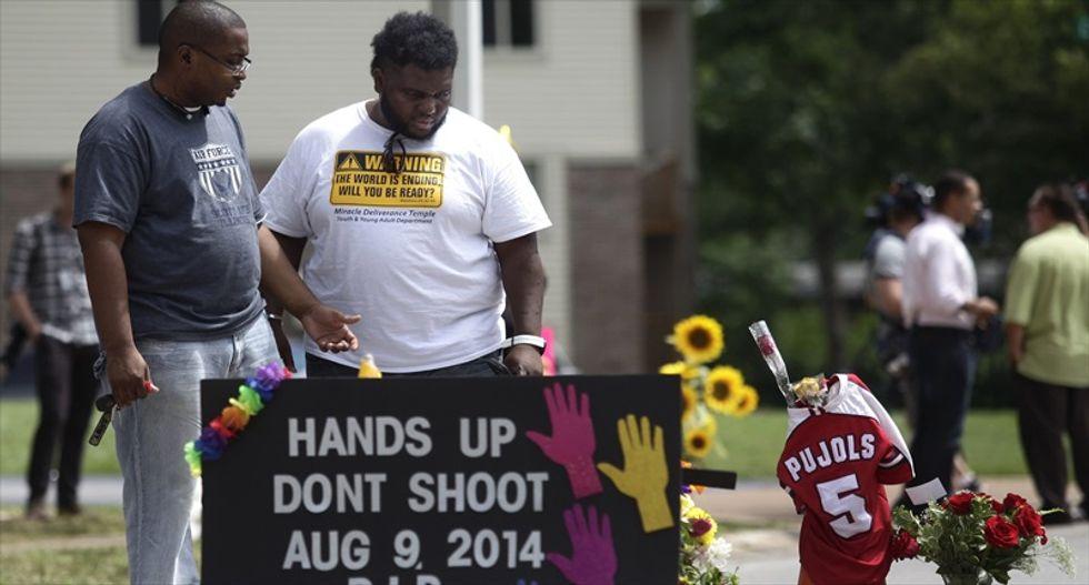 Justice Dept. tells Ferguson police to stop wearing Darren Wilson bracelets