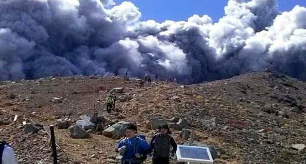 More than 30 feared dead on Japan's erupted Mount Ontake volcano