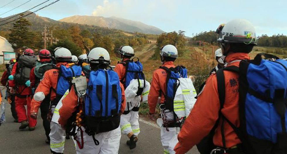 Four more bodies found on Japan's Mount Ontake volcano as typhoon nears