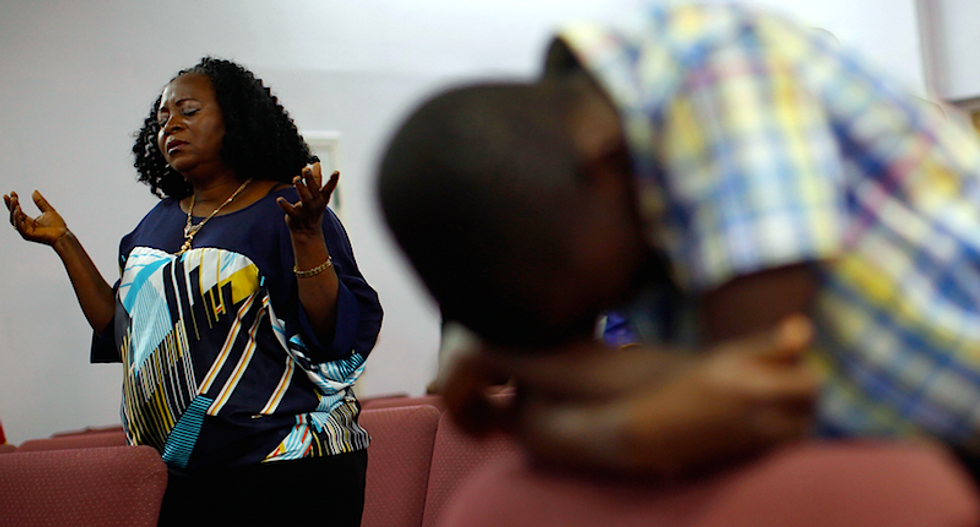African immigrants fear Ebola backlash as Dallas patient fights for life