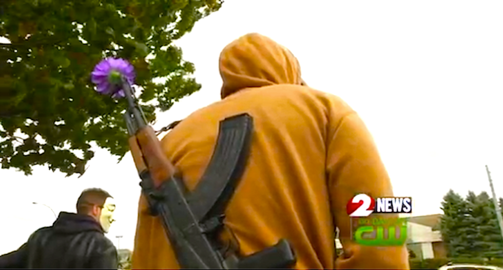 Protesters carry firearms into Walmart where cop gunned down black man over toy gun
