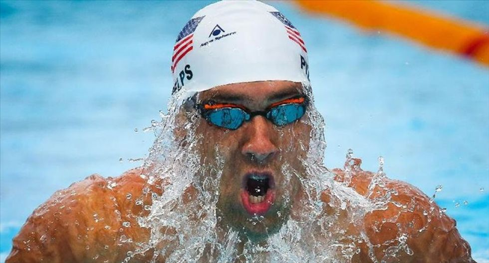 Olympic swimming champ Michael Phelps banned for six months after DUI arrest