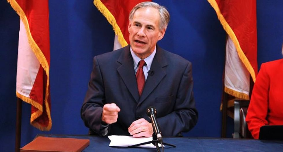 'Bury this!': Used menstrual products pelted at Texas governor after he signs 'fetal burial' order